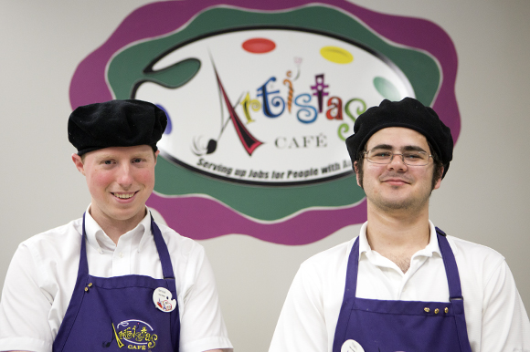 Bryan Martin (left) and Tony Aponte are employees at Artistas Cafe. - Julie Branaman