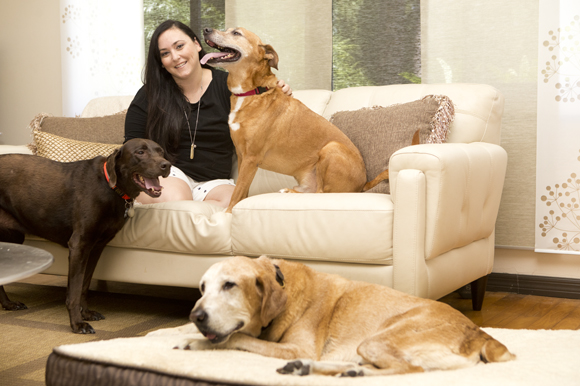 Courtney Wygle Landry, owner of Lay-Z-Dog pet beds at home with her pups. - Julie Branaman