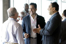 Sid Khurrum Hassan, founder of CUPS, chats with Mayor Buckhorn at an event at BoConcept.