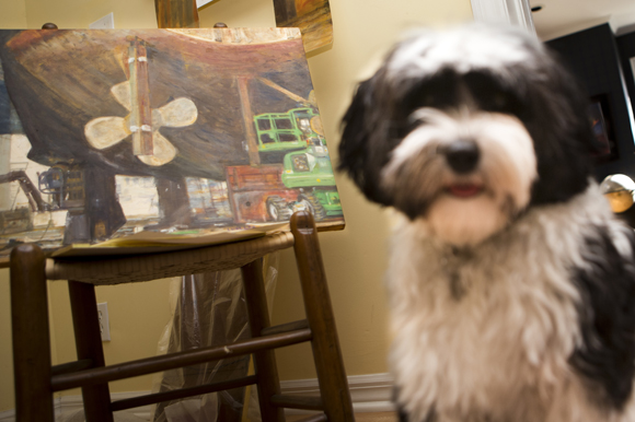 "Teddy poses with Laura Waller's Series ""Port of Tampa""."