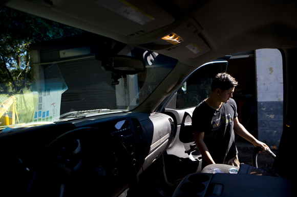 Joshua Colon works on a customer's car at Prime Time Car Care.
