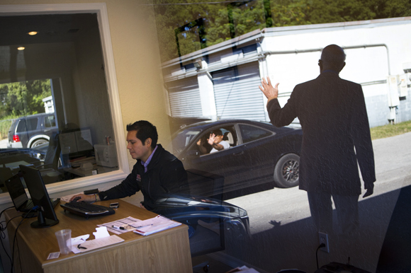 Julian Montenegro of Heavy Auto Parts (left) as THAP's James Hammond waves to a tenant.