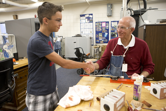 Sam Gardner thanks teacher Jon Wahnish for his help before leaving school Friday.