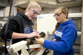 Hannah Edmonds (left) and Lauren Wonick-Cook work on designing a pen.