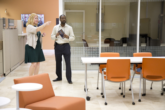 Lynn Schultz gives Dewayne Mallory a tour of the new Entrepreneur Collaborative Center in Ybor.