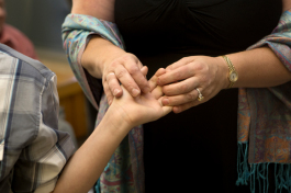Kerstin Kenty holds her son Mathew's hand on the day his adoption is finalized.