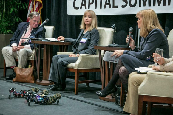 Luther Palmer presents a Lubotics robot to a panel of judges at the Access Capital Summit.