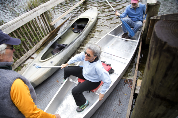 Catherine Valentine lands her canoe after paddling with the Florida Wildlife Corridor team on the Rainbow River.