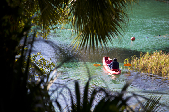 A kayaker warms up on the Rainbow RIver before the Florida Wildlife Corridor Expedition Trail Mixer.