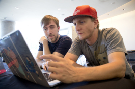 Swift of Major League Hacking and Matthias Elliott work during Project34 Hackathon at The Dali Muesum.