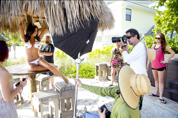 Photographer Jorge Alzarez works with Buccaneers Cheerleader Tessa Pino while shooting the squad's calendar.