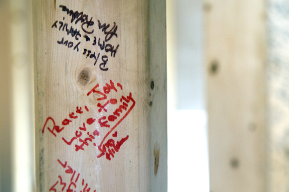 Messages to the Acevedo family were written on the studs of their home.