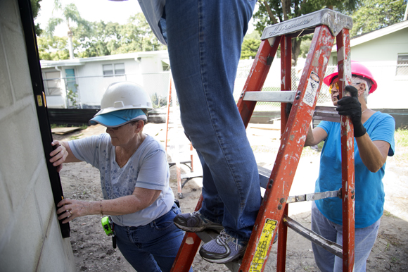 Ellen Poniewaz (left) and Nancy Doherty (right),  volunteer from St Michaels The Archangel Catholic Church, works on the Acevedo family home.