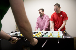 Jack Kenney and Brett Lee have a foosball break at kitedesk.
