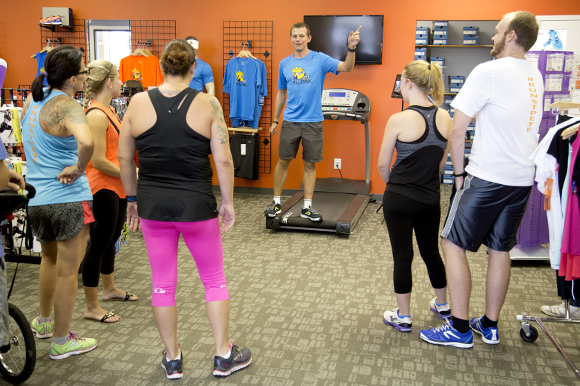 Cody Angell, owner of St Pete Running Company, chats with the Thursday run club.
