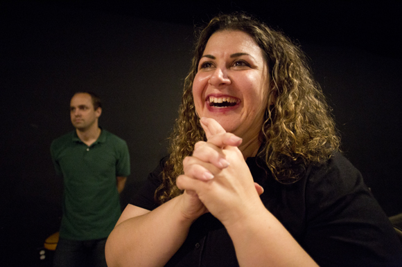 Crystal Haralambou watches her Improv Level II class as they perform at The Box in Ybor.