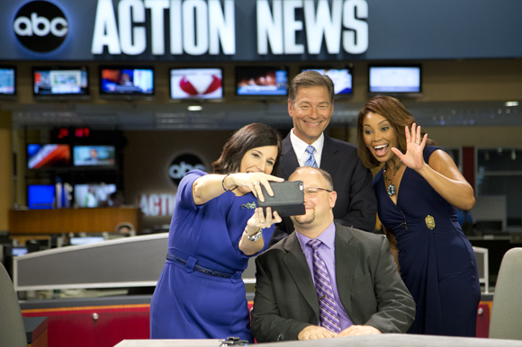 Lissette Campos, news anchors Dan Shaffer and Deiah Riley, take a selfie with Positively Tampa Bay guest Scott Richman.