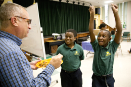 Academy Prep Center of Tampa Head of School Lincoln Tamayo samples a dish made by students.