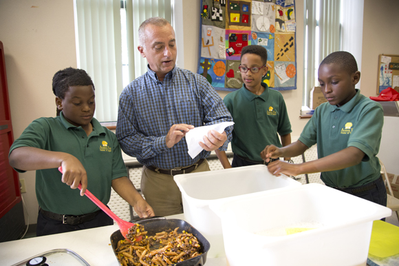 Academy Prep Center of Tampa Head of School Lincoln Tamayo helps students during a nutrition class.