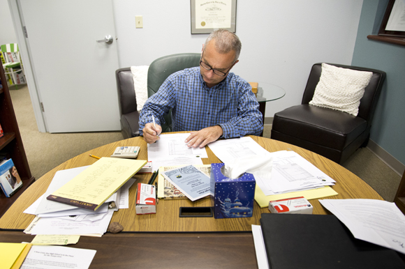 Lincoln Tamayo, Head of School at Academy Prep Center of Tampa, works at his desk.