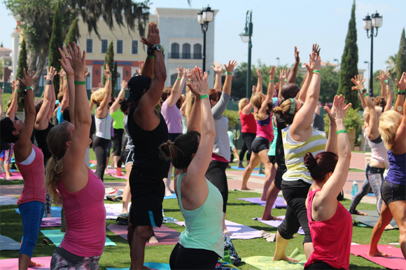 Yoga enthusiasts took to the mats in Orlando for a similar fundraising event focused on healthy living and exercise.