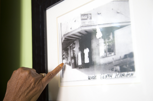 Carolyn Brayboy points to a picture of the Sydney Harden Grocery that is now Chief's Creole Cafe.