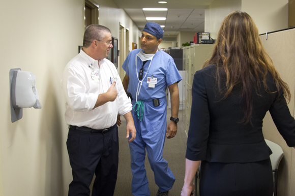 Haskelll Adler,  Senior Licensing Manager at Moffitt, and Tariq Chaudhry, MD, work together at Moffitt Cancer Center.