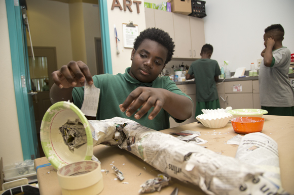 Omarion Clark, 12, creates a saxophone sculpture during Amanda Fleischbein's art class at Academy Prep Center of Tampa.