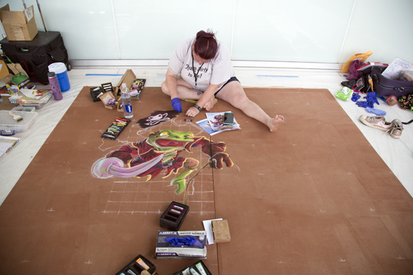 Artist Bridget Lyons works on a chalk design at Gasparilla Festival of the Arts.