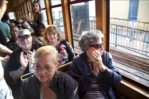 Tampa Streetcar riders clap for the Ries Brothers.