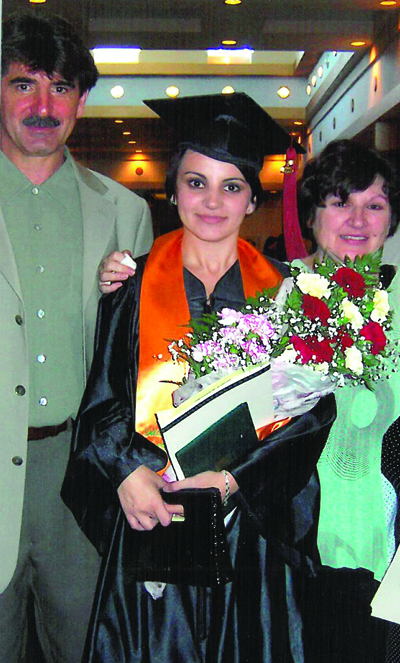 Karolak and her parents celebrate as she graduates from the University of South Florida St. Petersburg in 2005.