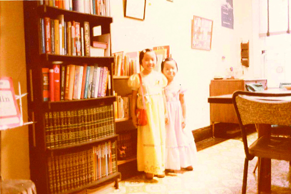 Phuong and her older sister on the day of their father's 1978 graduation from Penn State University.