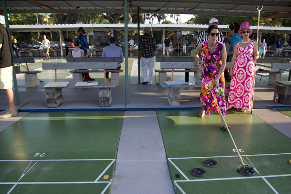 Carrie Whaley and Valerie Goff get in the shuffleboard spirit at Realize Bradenton's PopUps for a Purpose event.