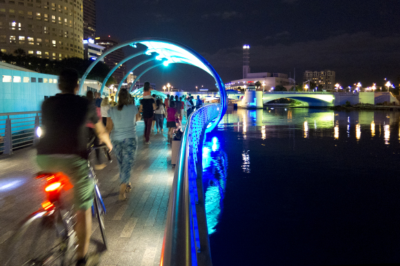 Tampa Riverwalk comes alive after dark with Lights on Tampa, festivals, and other activities.