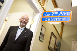 Councilman Charlie Miranda purchased this Ybor street sign at an auction. It now hangs above his office door.
