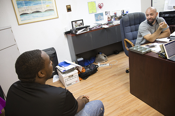 Bryan Taylor (left) chats with John Arroyo, program manager of Youthbuild.