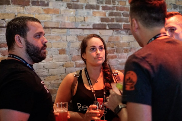 Local entrepreneurs chat with one another over drinks during the Tampa Bay Startup Week happy hour party at Franklin Manor.