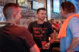 Event Organizer Ryan Sullivan speaks with Ned Pope and Nicholas Catania.