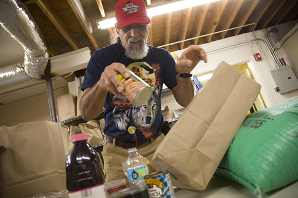 Arsenio Ramos, volunteers in the Beth-El Farmworker Ministry food pantry.