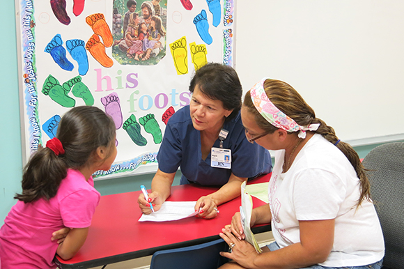 Madga Setzer, nurse at La Esperanza health clinic in Wimauma, assesses health needs.