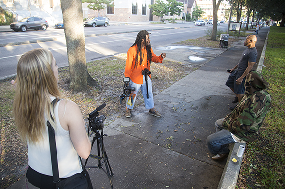 Jabaar Edmond directs Art In The City while USFSP Neighborhood News reporter Shelby Brown observes.