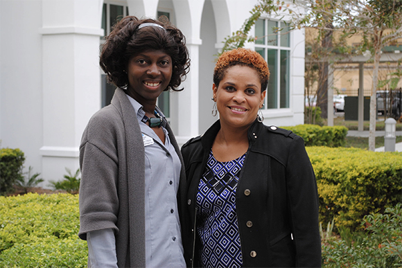 Claudia Gunns with Metropolitan Ministries, left, and Latisha Lomax.