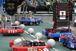 Student built robots face-off at the start of a match.