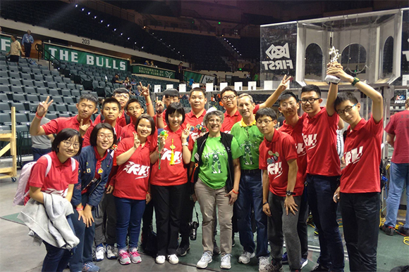 Steve and Terri Willingham with the Red Hurricanes FIRST Robotics Competition team from China.