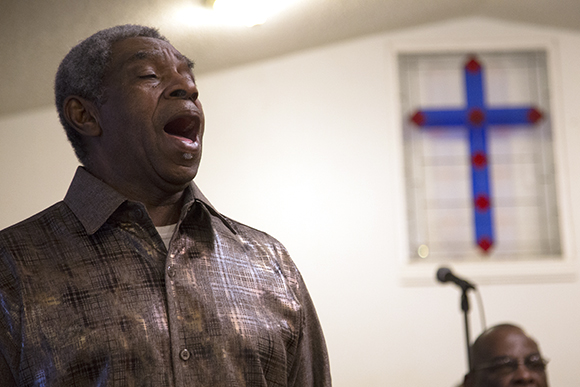 Deacon Robert Berrien sings during service at First Prospect Baptist Church in Wimauma.