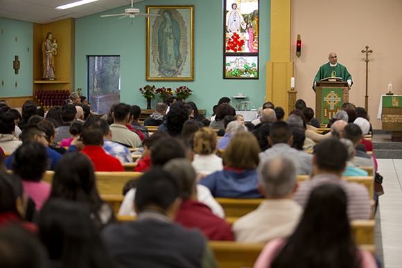 Father Gilberto Quintero leads Sunday Mass at Our Lady of Guadalupe in Wimauma.