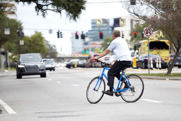 A cyclist crosses Westshore Blvd.