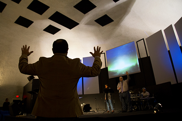 Pastor Carlos Irizarry leads Sunday service at Wholesome Community Ministries in Wimauma.