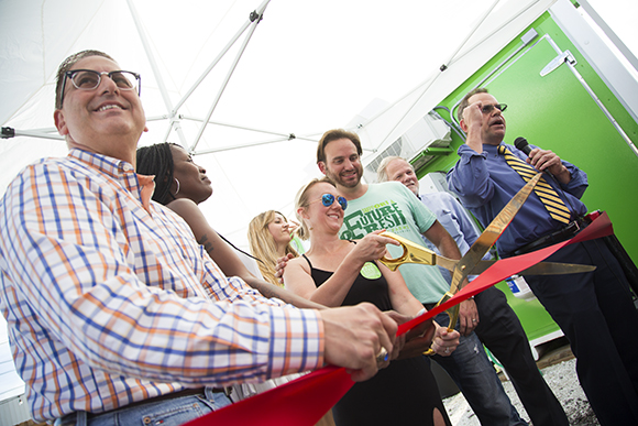 Mayor Rick Kriseman helps Shannon O'Malley and Brad Doyle cut the ribbon for the grand opening of Brick Street Farms in St. Pete.