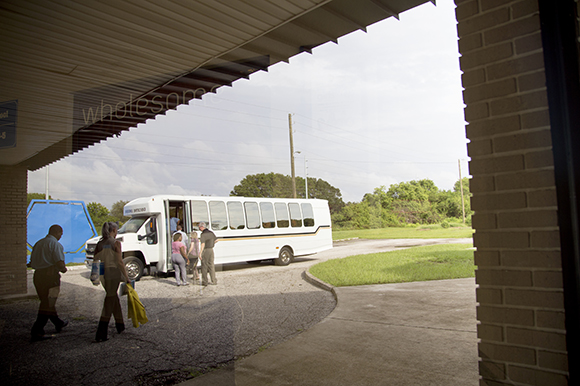 Participants board the bus at Wholesome Church